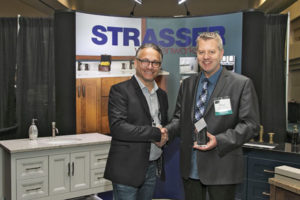 """LPG Executive Director Jeff MacDowell presents the """"Best Booth Award"""" to Strasser Vice President of Sales Peter Ollestad"""